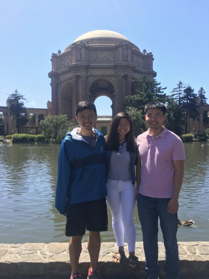 Junior Calina He stands with her two older brothers, Yizheng and Caleb He, while visiting San Francisco.