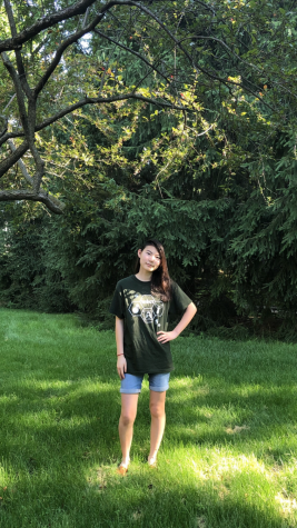 Karolena Zhou, staff member and sophomore, poses in her yard. Zhou said being an only child has made her who she is today and she doesn't want to change that.