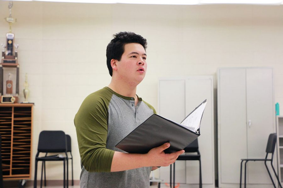 Senior Aidan Mellor reads from his binder of music during one of his choir classes. Mellor is a part of two of the top choirs at CHS: the Ambassadors show choir and Select Sound a capella choir. Outside of classes, he also helps organize events and assists with the Freshman boys choir.