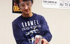 Senior Yannik Singh works on a chemistry experiment during Chemistry Club afterschool. In addition to the club, he also participates in Chemistry Olympiad.
