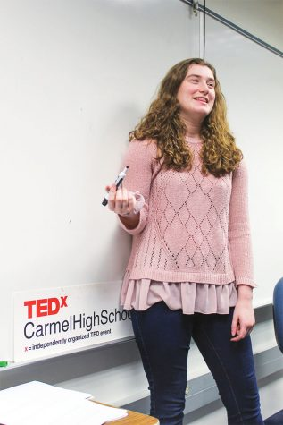 Sarah Konrad, TEDx president and junior, directs a meeting. Konrad said the logistical work leading up to the talk is stressful, but worth the effort.