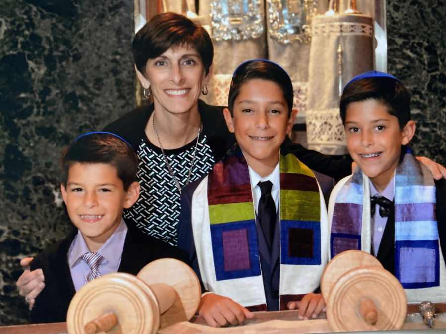 Submitted Photo || Jacob Kurlander Junior Jacob Kurlander (right) poses for a photo with his mother, Beth Kurlander, twin brother, junior Eli Kurlander (center), and little brother, freshman William Kurlander (left) at his b'nai mitzvah. Jacob had his b'nai mitzvah with his twin brother.