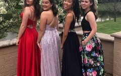 Submitted Photo || Lydia Yong Senior Lydia Yong (second from the right) poses with her friends in her dark blue prom dress.