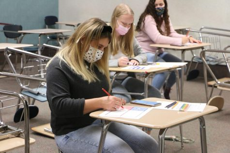 "Senior Alexsandra ""Aleks"" Shepherd works on an activity during Spanish Club. As a member in the club, Shepherd attends meetings as a part of the Greyhound Hybrid cohort."