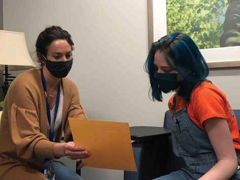 Senior Alexandra Warhurst (RIGHT)  talks to 10th-12th grade counselor Casey Danubio  (LEFT) while staying socially distant. At CHS, counselors hope to communicate better with students in order to help student mental health.
