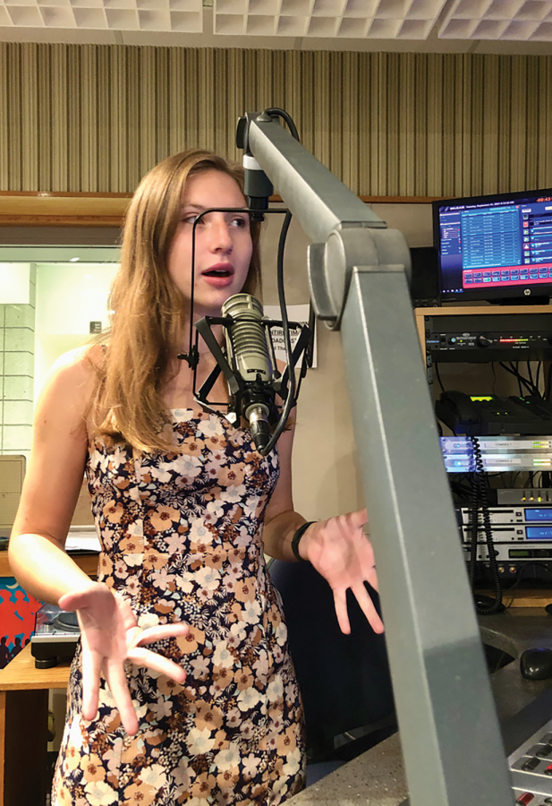 """Caroline Houck, co-host of  WHJE live show """"In Her Zone"""" and senior, conducts a live show during her Radio 7 class on Sept. 21. Houck said radio has taken on an increased importance since the start of the pandemic."""