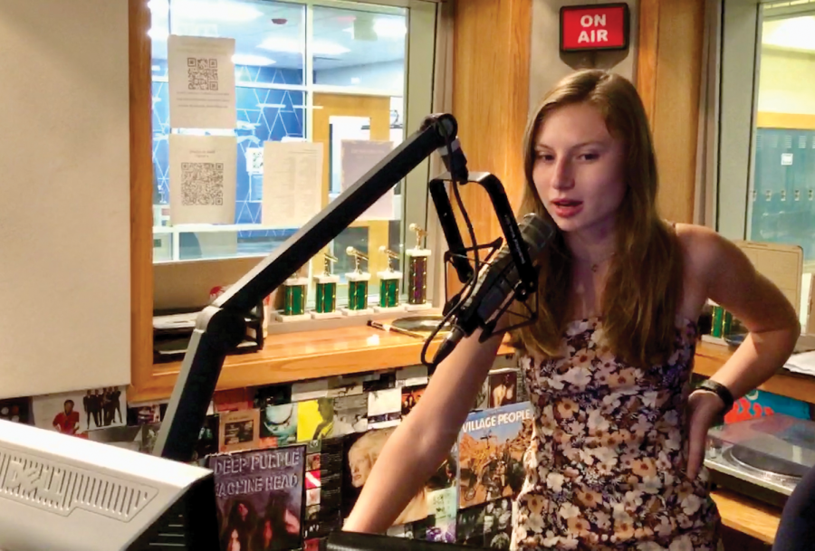 """Caroline Houck, co-host of  WHJE live show """"In Her Zone"""" and senior, operates the sound board during her independent live show on Sept. 21. Her regular show, """"In Her Zone,"""" which she co-hosts with senior Hali Papacharalambous, goes live every Thursday from 5:30 to 6:30 p.m. on 91.3 FM."""