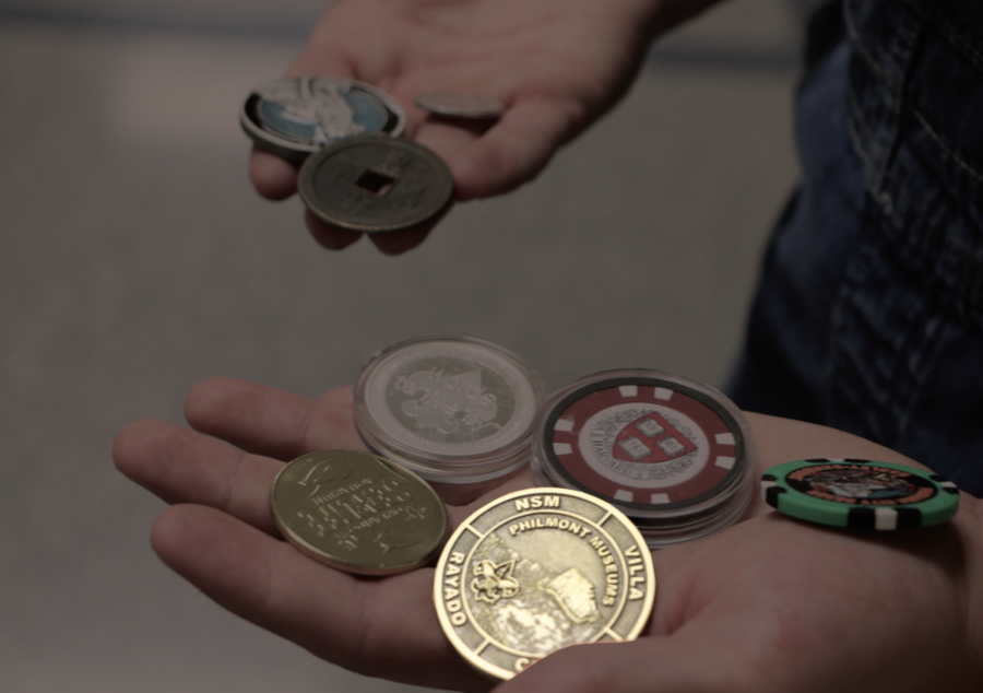 Senior Alex Rushinksy shows some of his coins which he collects. Rushinsky said the Philmont coin, shown in the photo is from New Mexico.