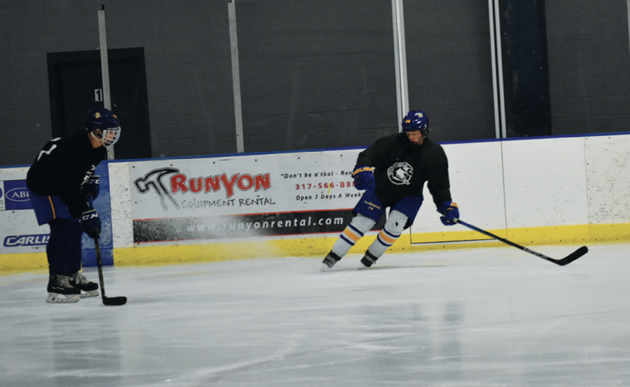 """Senior Nash Cheslock does a """"hockey stop"""" during practice with his teammate senior Joseph Youkilis. Cheslock said the practices are complex with different factors to focus on like timing."""