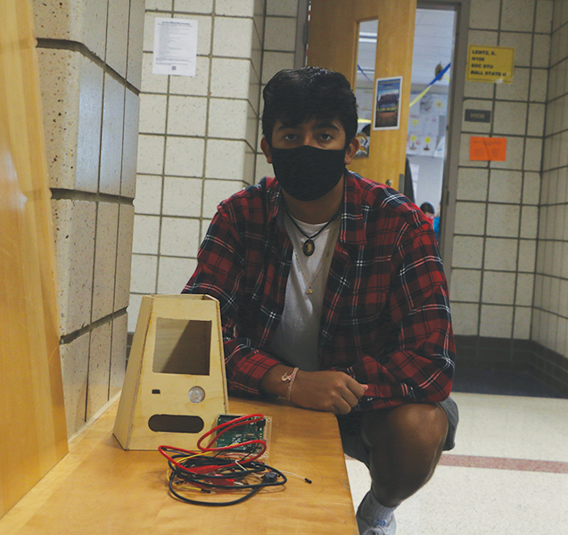 On Sept. 21, Shiva Viswanath, InvenTeam member and senior, shows off the makings of the InvenTeam's newest invention.